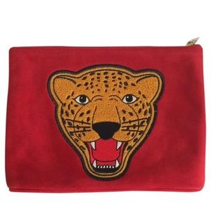 Brand new Charlotte Olympia limited edition clutch